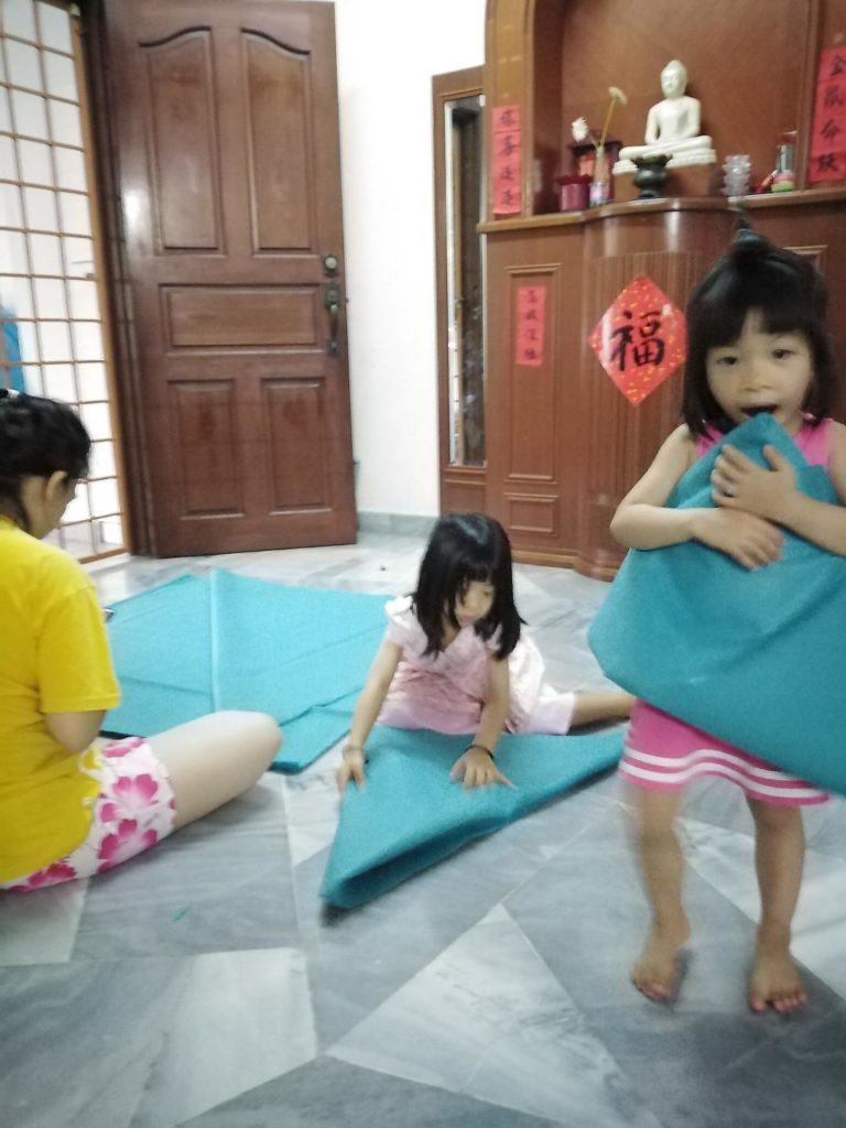Young children help to pack and carry